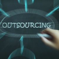 """outsourcing"" word with hand pointing to it"