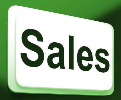 """sales"" written on a sign with green background"