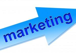 """marketing"" word on a blue arrow"